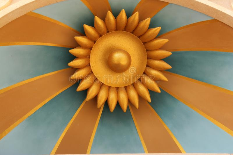 The Sun Ray. This meticulously crafted artifact with vibrant golden colour painted on it symbolises the ray of the sun shining on us stock photo