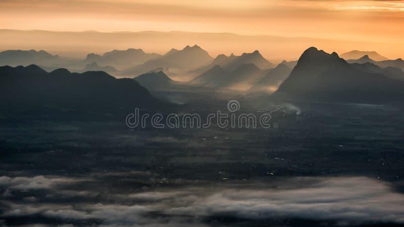 Sun ray and mountain stock photo