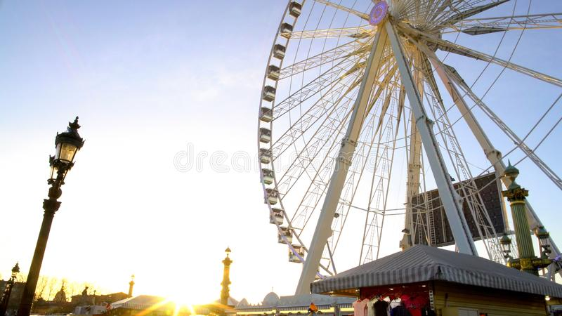 Sun ray penetrating giant construction of observation wheel, theme park, Paris royalty free stock images