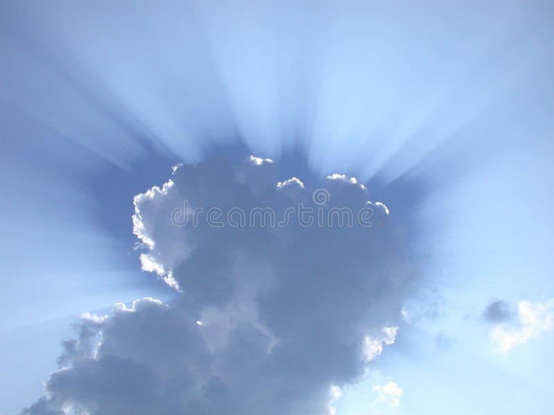 Sun rays through the clouds stock photography