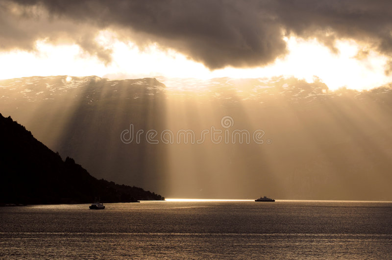 Sun rays through clouds royalty free stock images