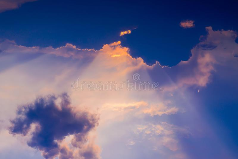 Sun rays through the clouds sunset royalty free stock photography