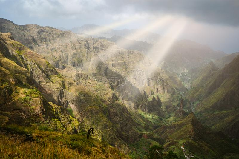 Sun rays coming through the clouds in rocky mountain landscape of in Xo-xo valley in Santo Antao island, Cape Verde royalty free stock photo