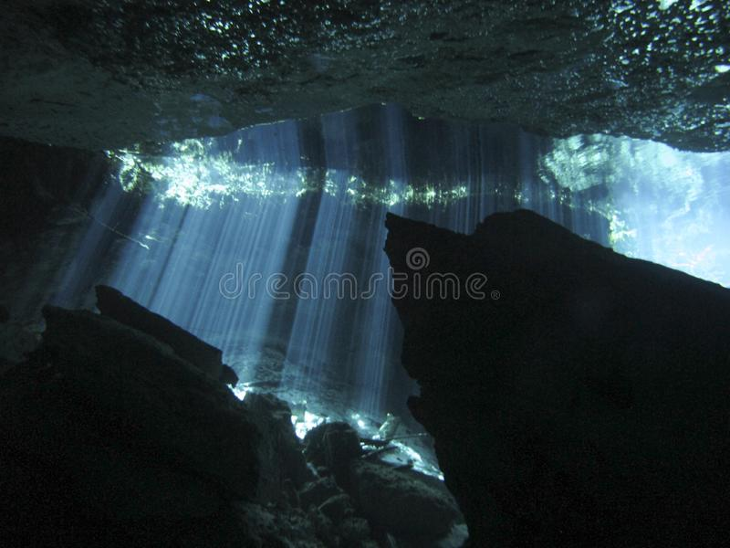 Sun rays entering the water in an underwater cave. Reflection of light - Underwater at cenote Chac Mool in the Riviera Maya, Mexico stock images