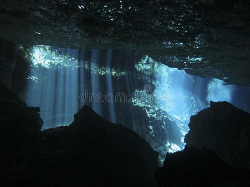 Sun rays entering the water in an underwater cave. Reflection of light - Underwater at cenote Chac Mool in the Riviera Maya, Mexico stock photo