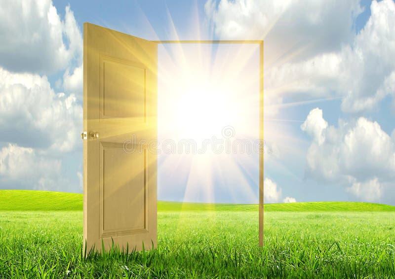 Sun rays and open door royalty free stock photo