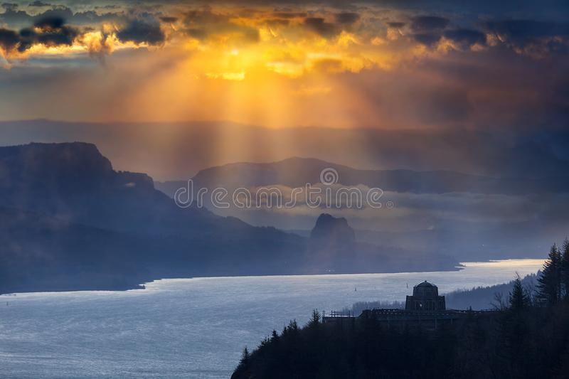 Sun Rays over Columbia River Gorge during Sunrise. Sun rays over Crown Point and Beacon Rock along Columbia River Gorge during sunrise royalty free stock images