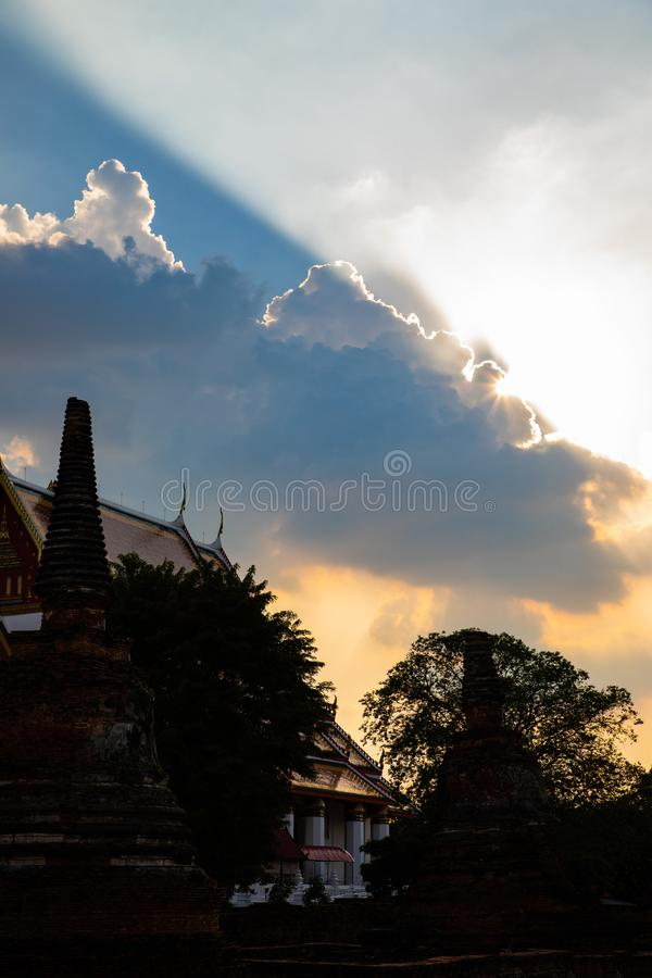 Sun rays shining from behind a big cloud stock photos