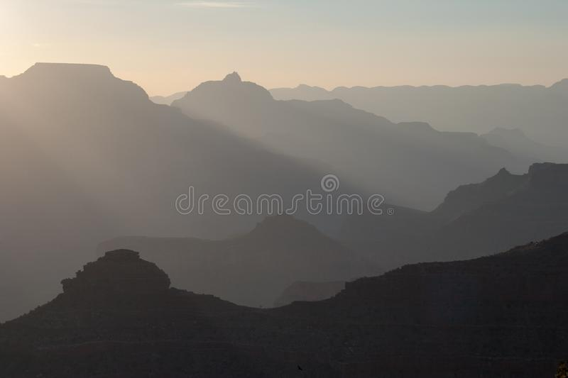 Sun rays at sunrise in Grand Canyon national Park. Sun rays at sunrise from Mather Point on South Rim of Grand Canyon National Park, Arizona in summer royalty free stock photos