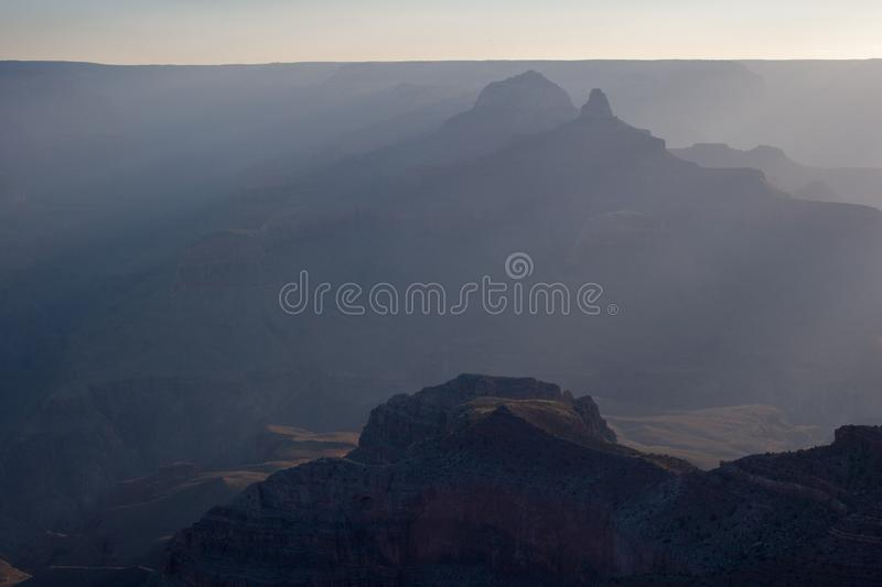 Sun rays at sunrise in Grand Canyon national Park. Sun rays at sunrise from Mather Point on South Rim of Grand Canyon National Park, Arizona in summer royalty free stock image