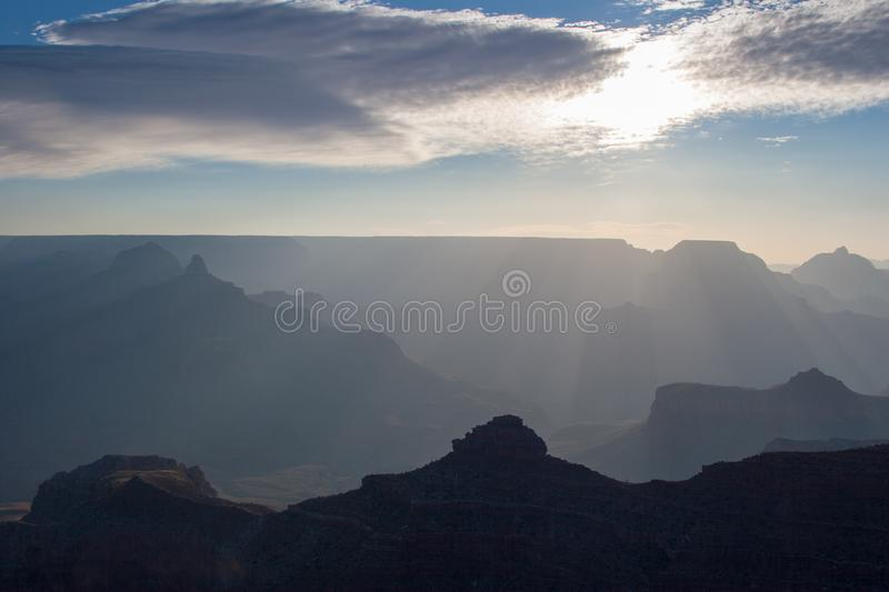Sun rays at sunrise in Grand Canyon national Park. Sun rays at sunrise from Mather Point on South Rim of Grand Canyon National Park, Arizona in summer stock photography