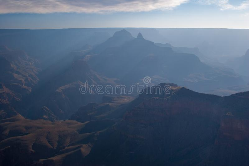 Sun rays at sunrise in Grand Canyon national Park. Sun rays at sunrise from Mather Point on South Rim of Grand Canyon National Park, Arizona in summer stock photos