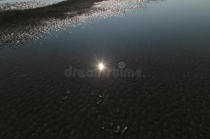 Sun reflect in water of Beach in Sea when water down. Sun reflect in water of Beach in the Sea when water down royalty free stock images