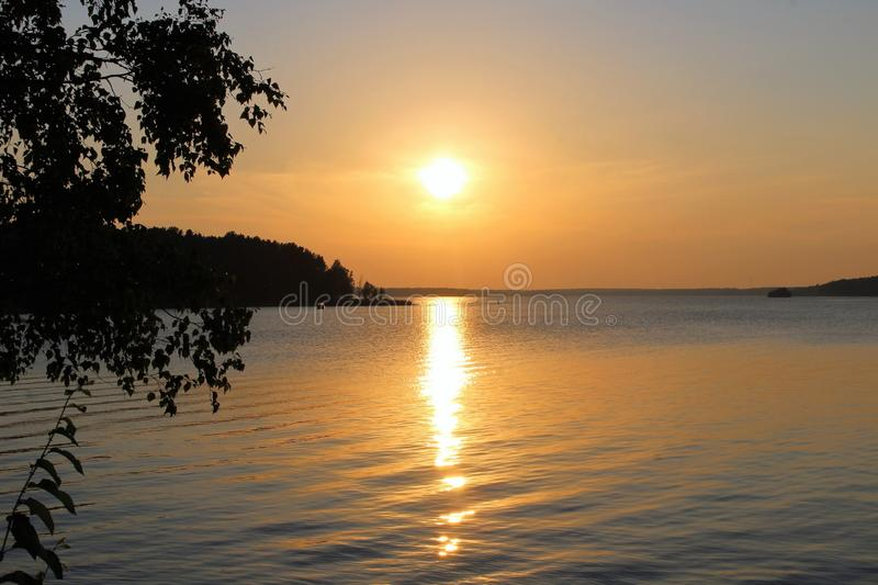Beautiful August evening in Luleå. The sun is reflected in the bay on a beautiful August evening in the Northern Port of Lule royalty free stock photos