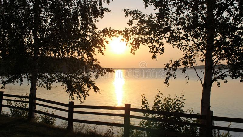 Beautiful August evening in Luleå. The sun is reflected in the bay on a beautiful August evening in the Northern Port of Lule stock images