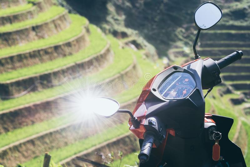 Sun reflecting in motorcycle mirror with Sapa rice field on background, Vietnam royalty free stock photos
