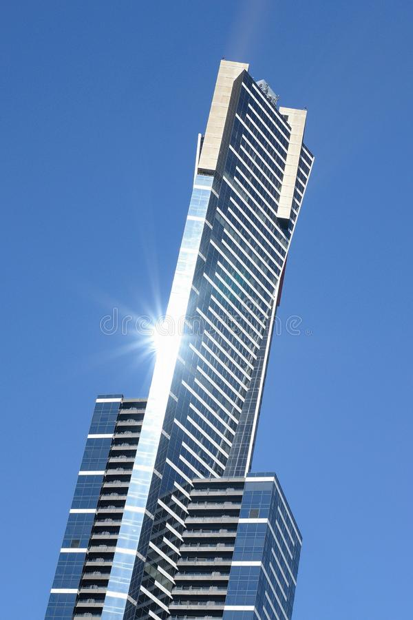 Sun reflecting off the Eureka Tower in Melbourne, Australia. Sun reflecting off eureka tower melbourne australia light reflection skyscraper tall sunray blue royalty free stock photo