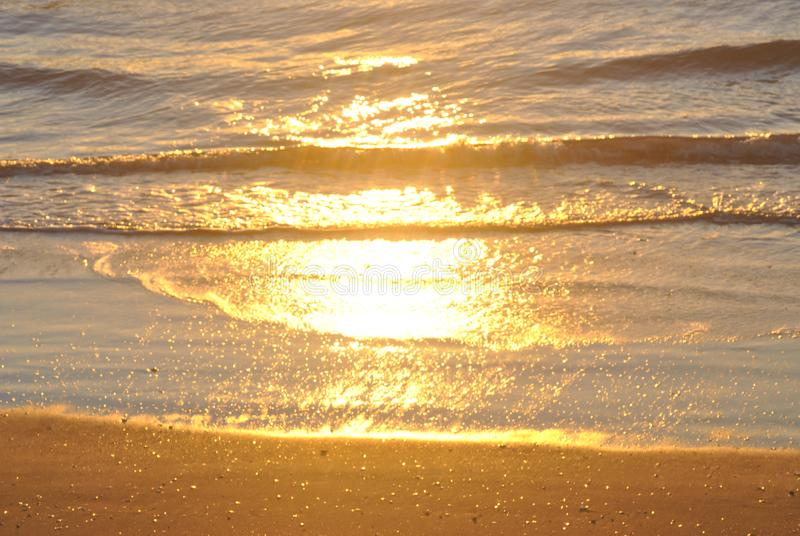Sun reflecting off water royalty free stock photography