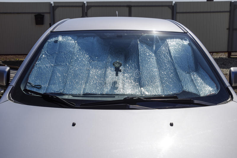 Sun Reflector windscreen. Protection of the car panel from direct sunlight stock images