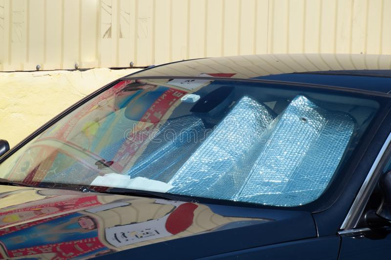 Sun Reflector windscreen. Protection of the car panel from direct sunlight. Protection of the car panel from direct sunlight. Sun Reflector windscreen royalty free stock photos