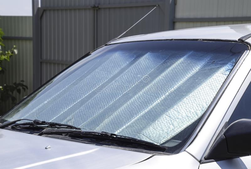 Sun Reflector windscreen. Protection of the car panel from direc royalty free stock image