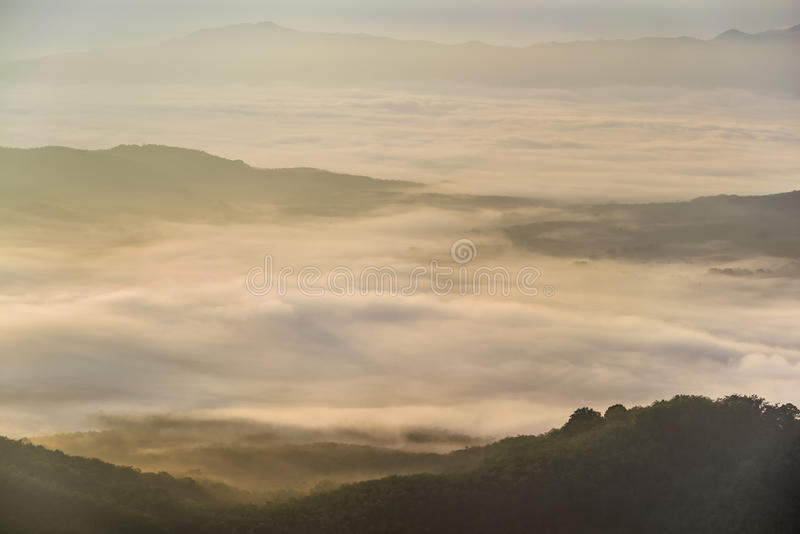 Sun rise on the fog mountain royalty free stock photography