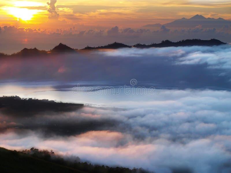Sun rise over batur lake stock images