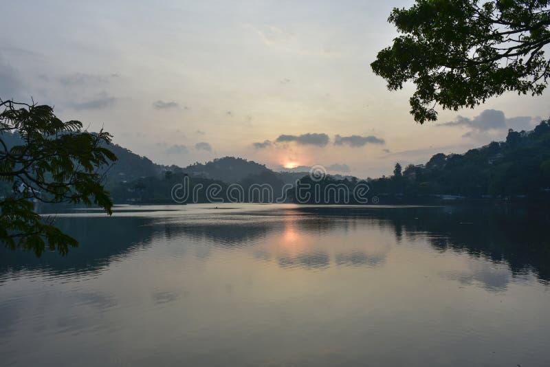 Sun rise over Kandyan lake royalty free stock photo