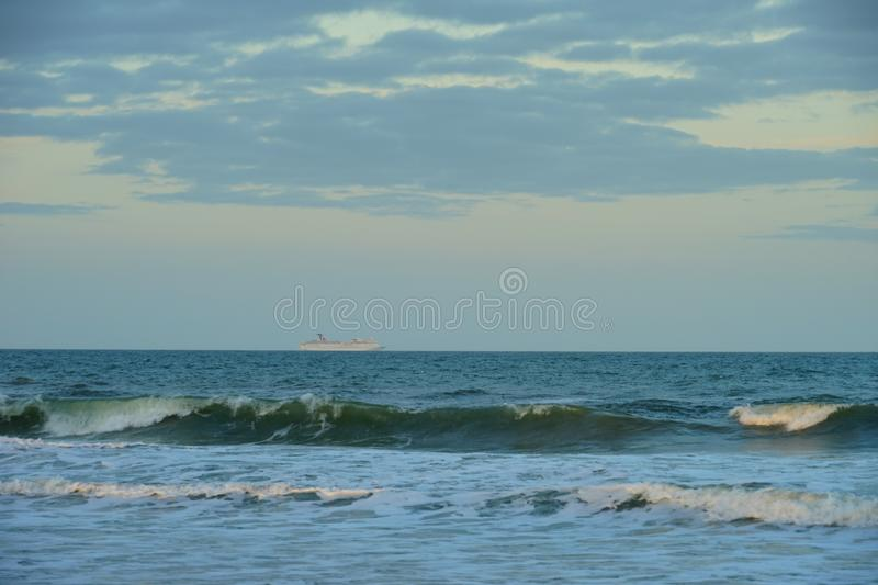 Jacksonville beach sun rise. Sun rise and pick cloud, taken in Jacksonville, florida royalty free stock photography