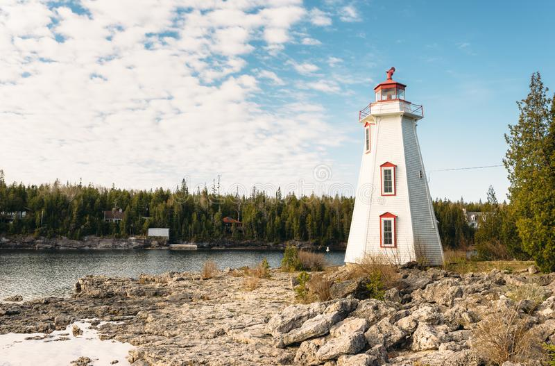 Lighthouse overlooking Big Tub Harbour, Tobermory, Ontario royalty free stock images