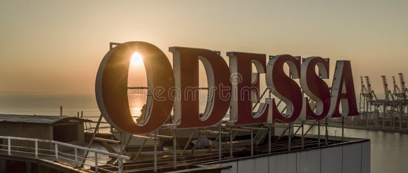 Sun rises behind large Odessa Sign Ukraine stock images