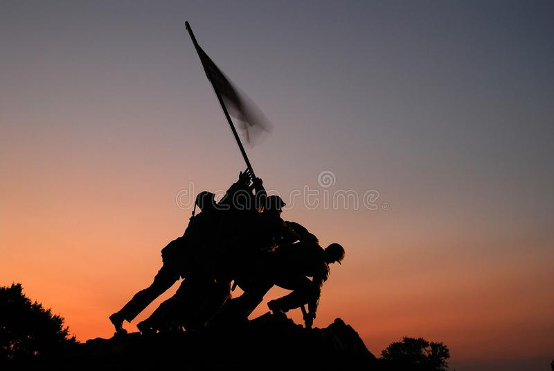 US Marine Corp Memorial, Arlington. The sun rises behind the Marine Corp Memorial near Washington, DC royalty free stock photography