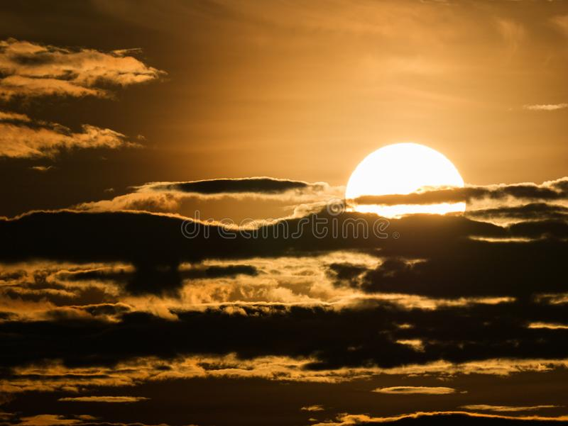 Sun Rises Through The Clouds Streaked stock image