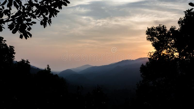 Sun rises over Nam Khan national park valley royalty free stock photography