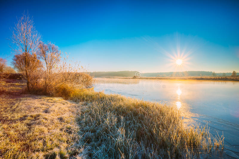 Sun Rises Over River. Autumn Frost Frozen River Covered With Thin Ice. stock photos