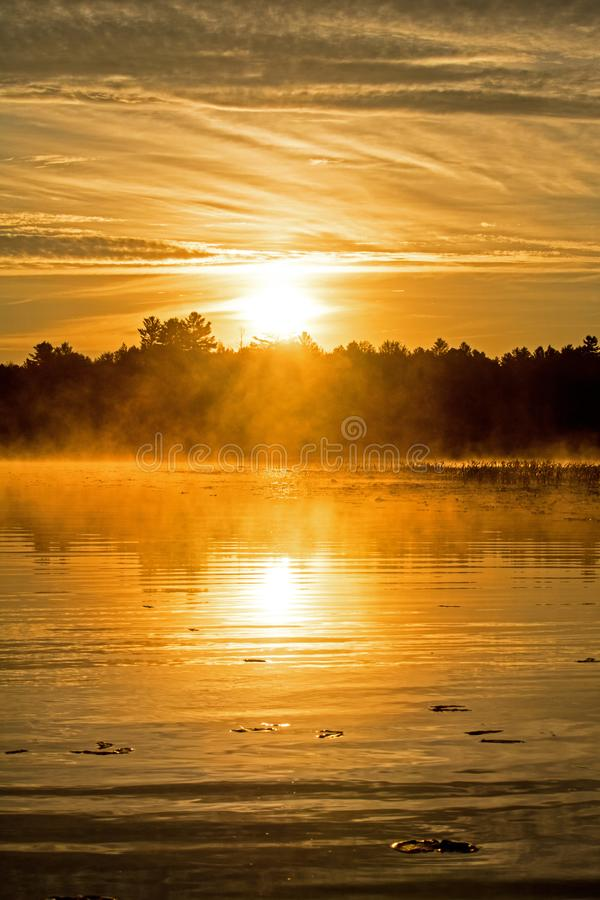 Sunrise Burns Through The Early Morning Mist royalty free stock photo