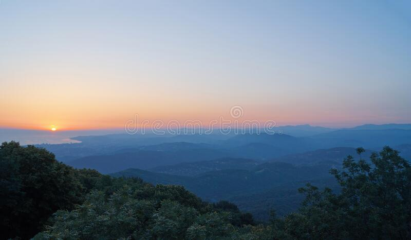 The sun rises from the sea, view from the mountain royalty free stock photography