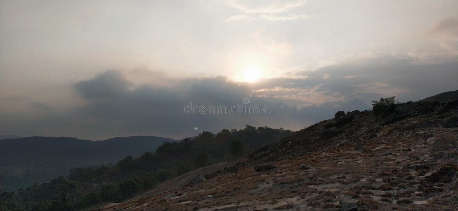 Sun rising above the clouds. Sunrise royalty free stock image