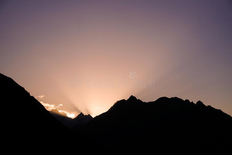 Sun rising behind the mountains. View from Eagle`s nest viewpoint. Hunza valley, Gilgit-Baltistan, Pakistan stock images