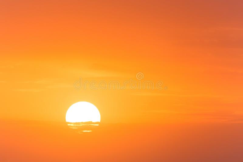 Sun rising behind slight clouds. View on sun rising behind slight clouds stock images