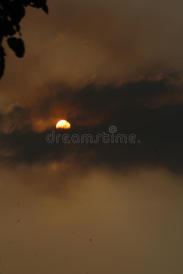 Sun rising from clouds. Sunrise, morning, nature, beauty royalty free stock image