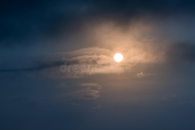 Sun rising. On dark sky royalty free stock photo