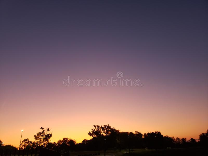 The Sun rising in the day. Nature, skyline royalty free stock photo