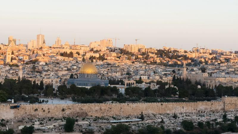 The sun rising at dome of the rock in jerusalem. The sun rising at dome of the rock mosque from the mount of olives in jerusalem, israel royalty free stock photos