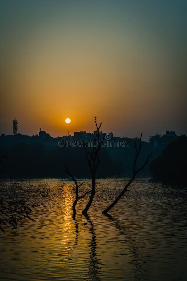 Sunrise at Autumn. Sun is rising at Hauz Khas Lake in autumn royalty free stock images