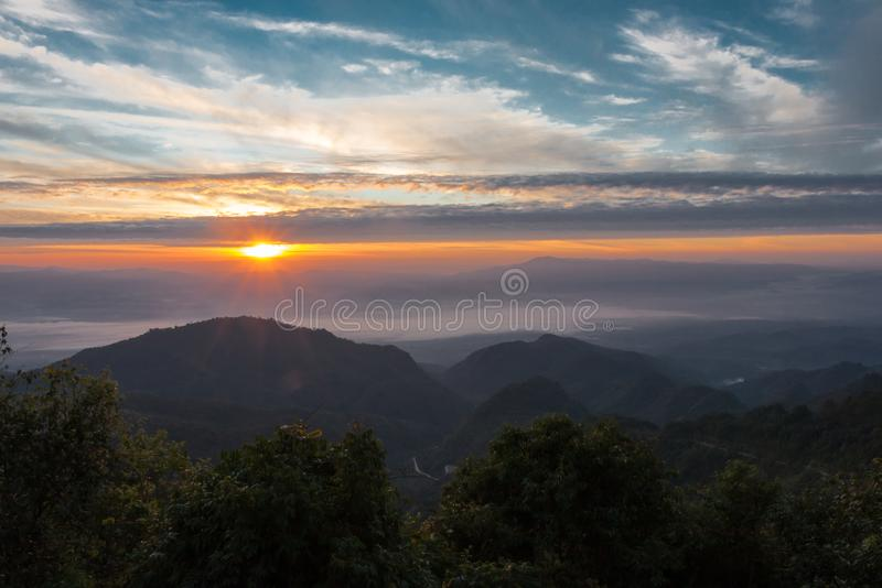 The sun is rising in the high mountains Winter morning. Mountain view stock photo