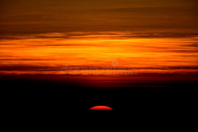 The sun is rising from the horizon. Line royalty free stock photos