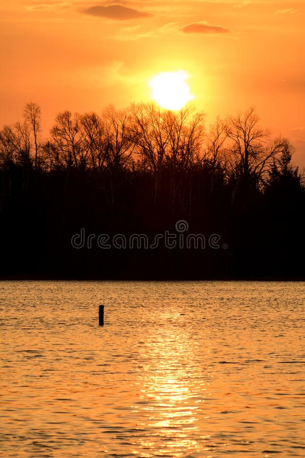 Sun Rising At Island Lake Conservation Area. The sun pops over the treeline at sunrise at the eastern end of Island Lake Conservation Area in Orangeville stock photography