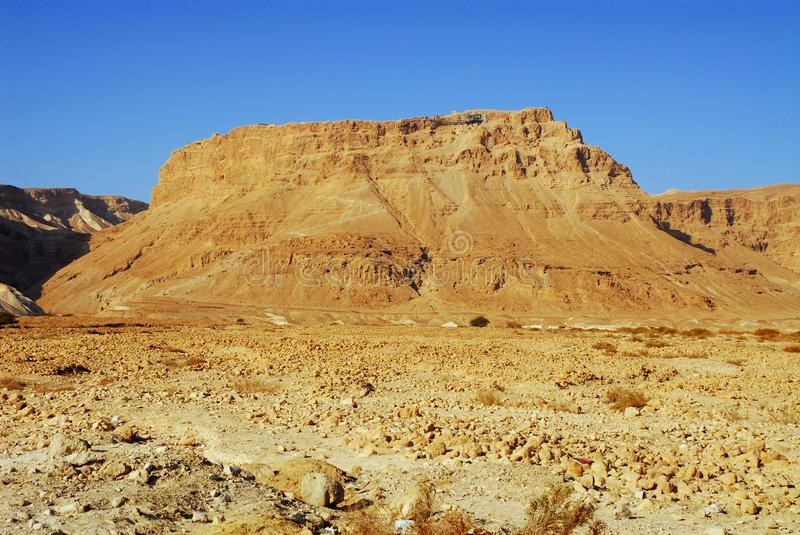 The sun is rising on Masada. The historical place where the big jewish mass suicide occurred stock photography