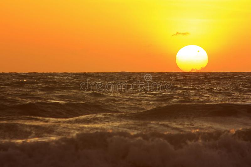 The sun is rising in the morning from the sea. royalty free stock photos